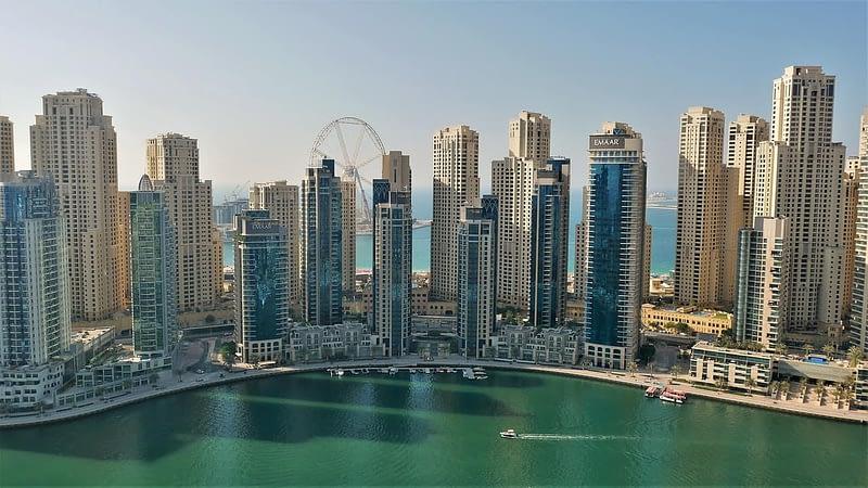 Dubai Marina skyline in daylight with view of Jumeirah Beach Residence (JBR) and Ain Dubai