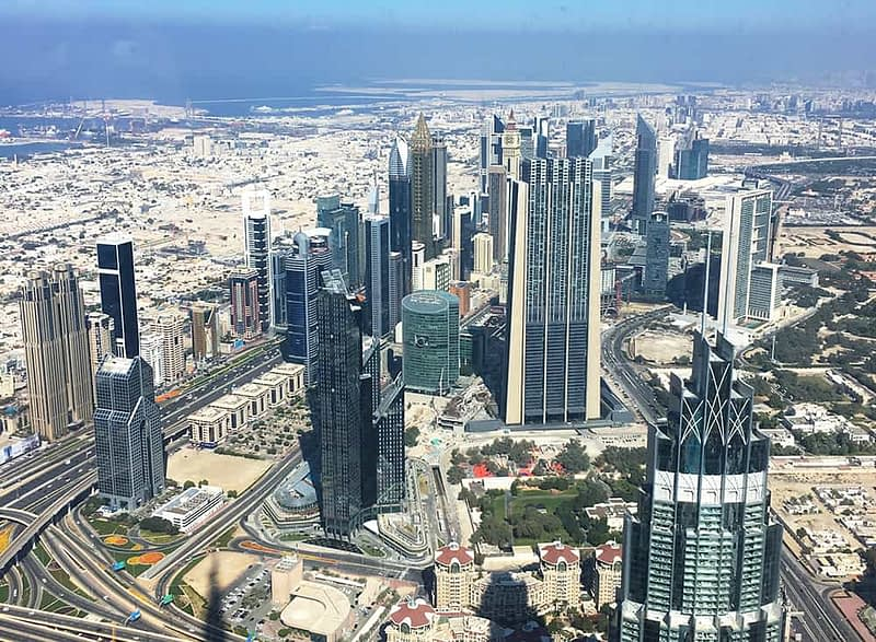 View from top of Burj Khalifa with view over DIFC in Dubai and Sheikh Zayed Road